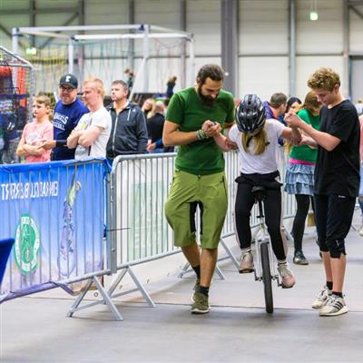 Trade Fair for Leisure and Outdoor Sports - Unicycle riding